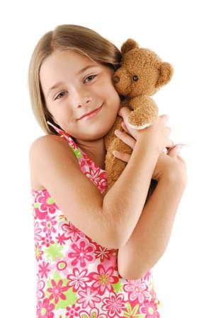 Little girl with teddy bear photo