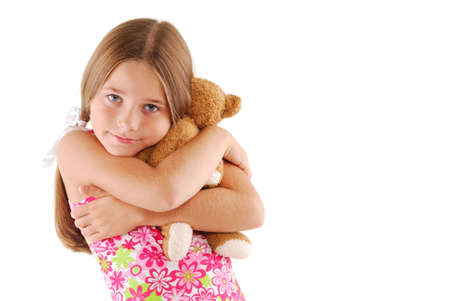 Young Child Girl Hugging A Teddy Bear