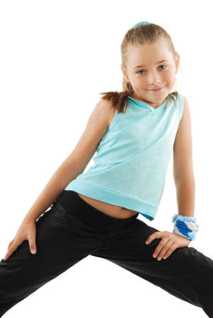 Little girl in role of gymnastics instructor Stock Photo