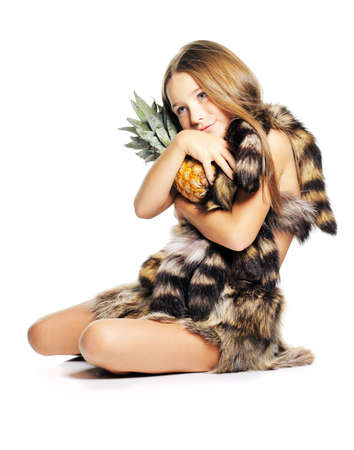 Little girl posing with pineapple dressed as prehistoric Stock Photo - 5814998