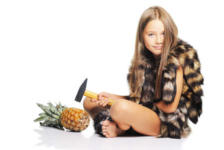 eastern european ethnicity: Little girl posing with pineapple dressed as prehistoric
