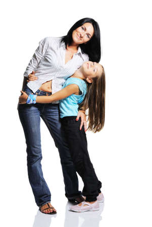 Mother with daughter isolated on white background. Studio shot with mirroring