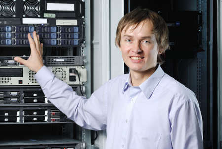 administrators: Portrait of young datacenter specialist in fron of equipment Stock Photo