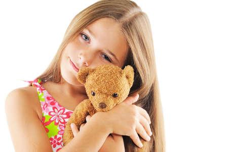 Little girl hugging bear toy. On white background Stock Photo