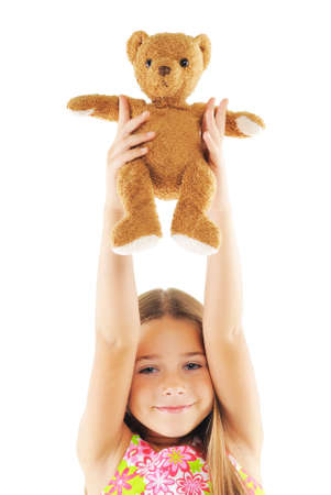 Little girl with bear toy. On white background photo