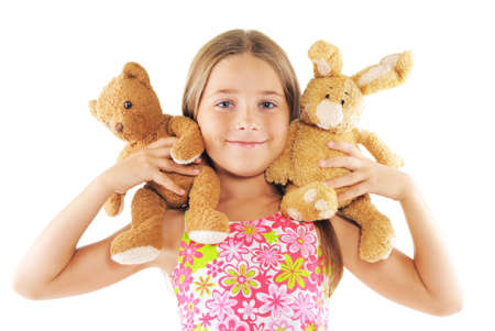 Little girl playing with toys. On white background Standard-Bild