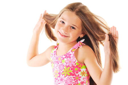 Portrait of the little blond girl playing with her hair on white background
