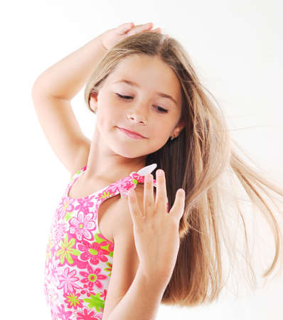 pink posing: Little  blond girl with long hair. White background