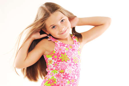 Portrait of little blond girl playing with her hair Stock Photo