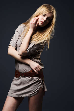 Seductive fashion portrait of young woman with flowing hair on dark background Stock Photo
