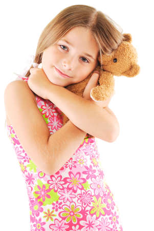 Little girl taking teddy bear on white background photo