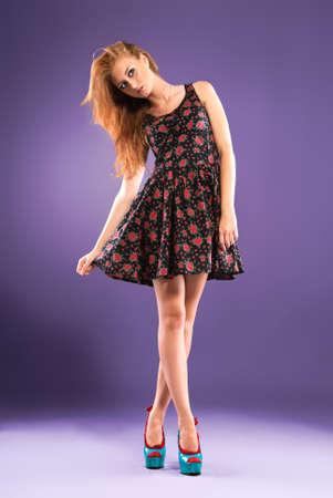 Beautiful red-haired girl Studio shot Stock Photo