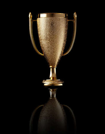 Gold cup with reflection on black background  photo