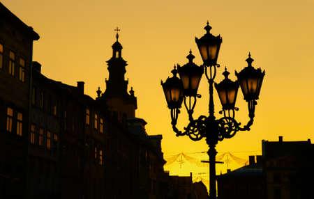 Sunset silhouette of old city lanterns in Lviv, Ukraine