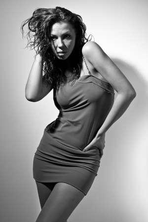 Black & white portrait of seductive young woman in short dress photo
