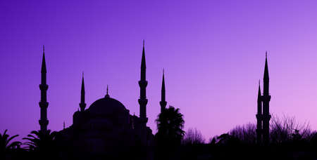 blue mosque: Beautiful silhouette of the Blue Mosque on blue-violet sky background  Istanbul, Turkey Stock Photo