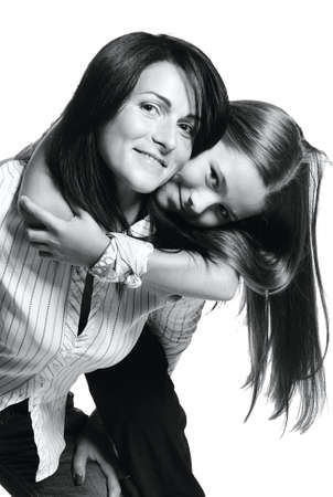 Mother playing with daughter on white background photo