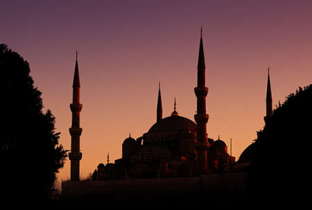 blue mosque: Beautiful silhouette of the Blue Mosque on violet-orange sky background  Istanbul, Turkey