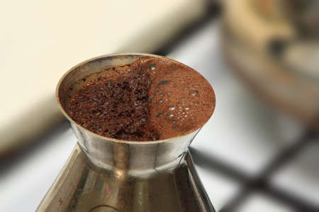 cezve: Beginning to boil black coffee in a cezve