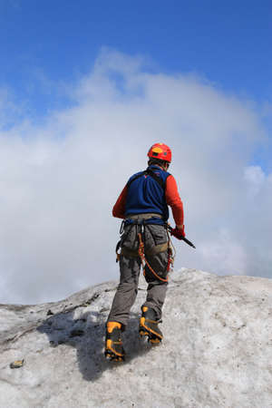 crampons: Climber learns to use crampons Stock Photo