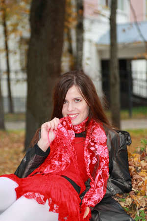 sexually: The beautiful girl sexually bites a red scarf