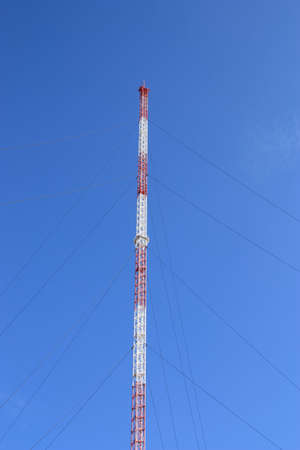 TV-tower under construction on the background of the clear blue sky photo
