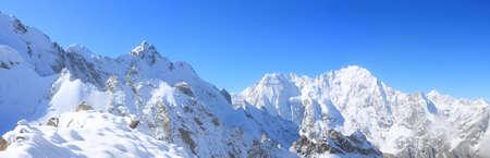 Panorama of snow-capped peaks of the main Caucasian ridge photo