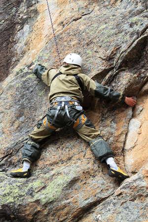 rockclimber: rock-climber trains on a difficult granite rock