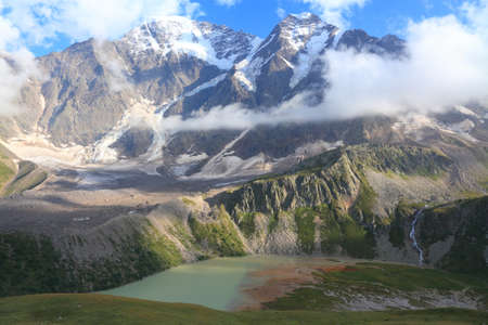 Donguz-Orun (4468 m) and Nakra (4277 m) peaks over the big lake photo
