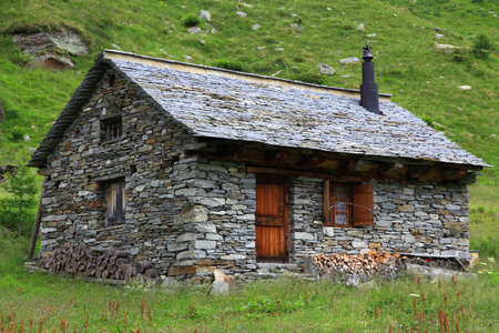 strange mountain: old mountain hut from natural stone