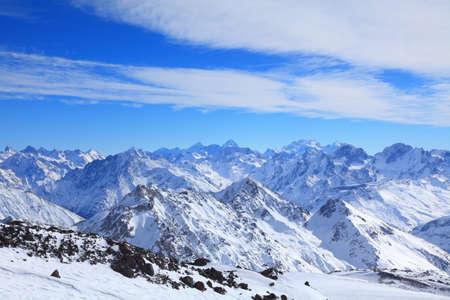 view of some tops of the main caucasus ridge in winter from elbrus 写真素材