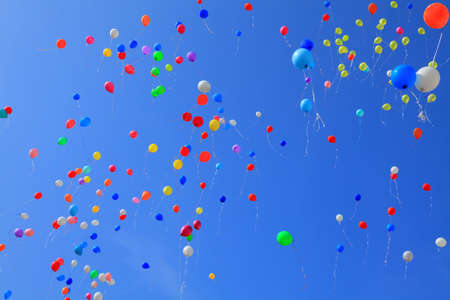 a lot of flying balloons on  the background of sky