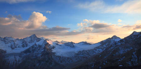 sunset in the caucasus ridge. View from the slope of the elbrus Banco de Imagens