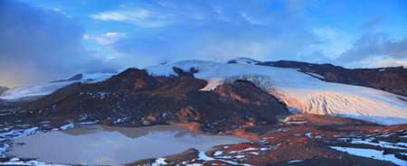 Glacial lake on the background of melting glaciers of the southern slope of Elbrus