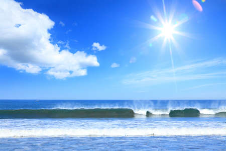 sea surf at the pacific ocean coaston a background of the sun and blue sky