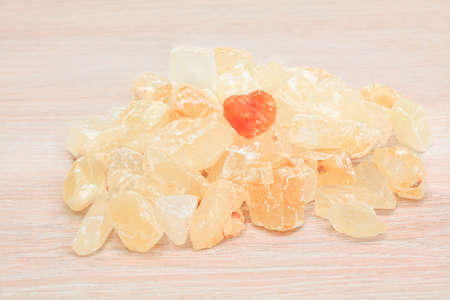 small pile of raw crystals on the blurred wooden background 写真素材