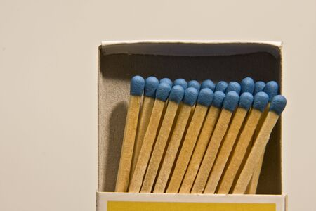 Boxes with matches of blue colour on light background Stock Photo