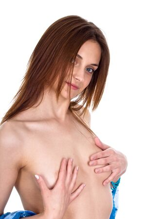 The young, beautiful girl covers breast with hands Stock Photo
