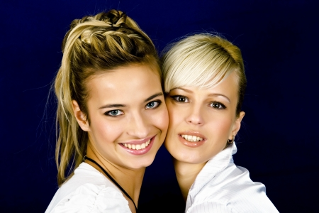 Two beautiful girls on dark background