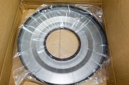 The seal of the robotic transmission рacked in polyethylene is in a cardboard box Imagens