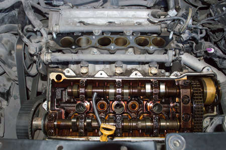 V6 petrol internal combustion engine with valve cover and intake manifold removed