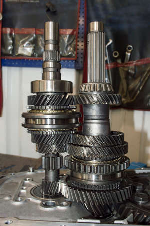 Vertical photo of the primary and secondary shafts of the mechanical transmission of a front-wheel drive car with gears and synchronizers