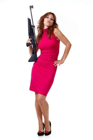 Sexy Action Girl with gun isolated over white photo