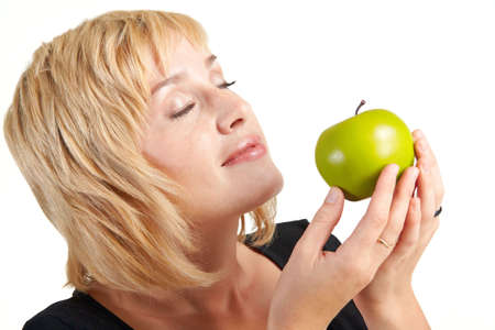 beautiful girl with apple isolated on a white photo
