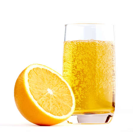 Half of A Orange with Glass of Lemonade isolated on a white photo