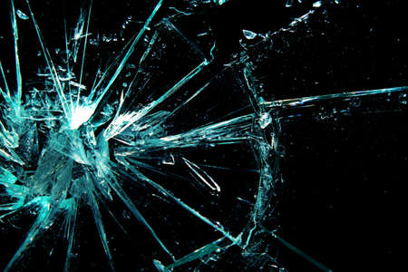 sabotage: broken glass on a black background Stock Photo