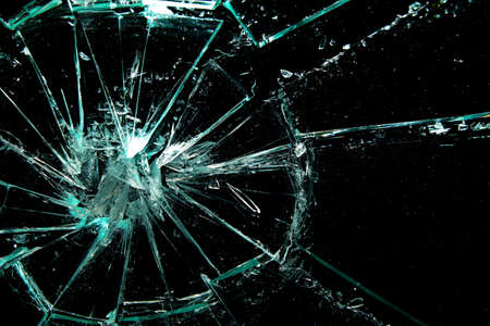 anger: broken glass on a black background Stock Photo
