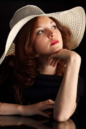 Young Pretty Woman in a hat Looking Upwards photo
