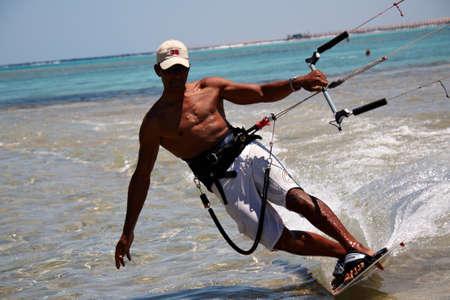 Unidentified man kitesurfing in Red Sea waters in Egypt, Sharm-El-Sheikh on April 24, 2010