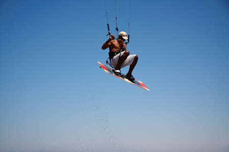 Unidentified man jumps high on kitesurf in Red Sea waters in Egypt, Sharm-El-Sheikh on April 24, 2010